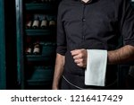 waiter in restaurant | Shutterstock . vector #1216417429