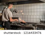 chef flaming food at a... | Shutterstock . vector #1216433476