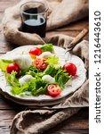 fresh healthy salad witn... | Shutterstock . vector #1216443610