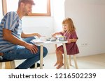 father and daughter having a... | Shutterstock . vector #1216502239