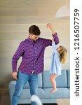 little girl holding on to her... | Shutterstock . vector #1216507759