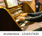 Male Hands Playing Organ...