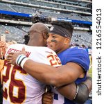 Small photo of EAST RUTHERFORD, NEW JERSEY - OCTOBER 28, 2018: Adrian Peterson talks to Saquon Barkley after NY Giants and WAS Redskins game at MetLife Stadium in Rutherford, New Jersey on October 28, 2018.