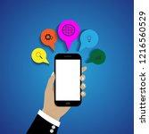 hand holding smart phone on... | Shutterstock .eps vector #1216560529