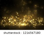 sparkling golden dust on black. ... | Shutterstock .eps vector #1216567180