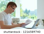 young handsome man works at... | Shutterstock . vector #1216589740