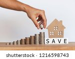 house model and wooden cubes... | Shutterstock . vector #1216598743