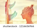 beautiful girl surfer with a... | Shutterstock . vector #1216636966