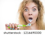 woman brushing cleaning teeth.... | Shutterstock . vector #1216690330