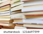 stack of books in library | Shutterstock . vector #1216697599