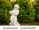 Sculpture Of A Girl In A Public ...