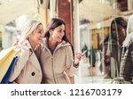 women in shopping. two happy... | Shutterstock . vector #1216703179