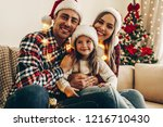 christmas. family. happiness.... | Shutterstock . vector #1216710430