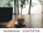 laptop and coffee cup on wooden ... | Shutterstock . vector #1216712716