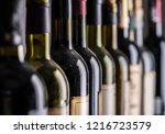 line of wine bottles. close up. | Shutterstock . vector #1216723579