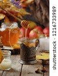 hot fall tea with organic honey ... | Shutterstock . vector #1216733989