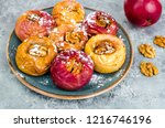 baked homemade apples with nuts ... | Shutterstock . vector #1216746196