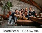 friends watching sport match at ... | Shutterstock . vector #1216767406