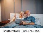 senior couple in bed shopping... | Shutterstock . vector #1216768456