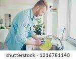 good looking man in blue shirt... | Shutterstock . vector #1216781140