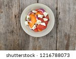 tomatoes salad on the wooden... | Shutterstock . vector #1216788073