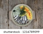 sprat dishes with potatoes | Shutterstock . vector #1216789099