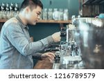 serious young asian barista... | Shutterstock . vector #1216789579