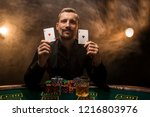 man is playing poker with a... | Shutterstock . vector #1216803976