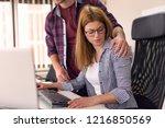 businessman sexually harassing... | Shutterstock . vector #1216850569