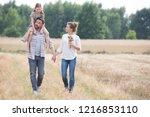 young caucasian family walking... | Shutterstock . vector #1216853110