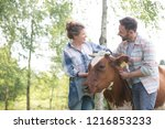 female and male farmers... | Shutterstock . vector #1216853233