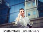 urban businessman is making a...   Shutterstock . vector #1216878379