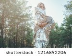 beautiful girl is wrapped in a... | Shutterstock . vector #1216892206