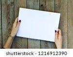 woman hand holding blank paper...   Shutterstock . vector #1216912390