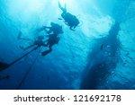 scuba divers under diving boat | Shutterstock . vector #121692178