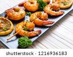 grilled tiger shrimps skewers... | Shutterstock . vector #1216936183