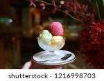 a bowl of ice cream scoops of... | Shutterstock . vector #1216998703