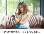 young beautiful asian woman... | Shutterstock . vector #1217025313