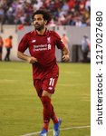 Small photo of EAST RUTHERFORD, NJ - JULY 25, 2018: Mohamed Salah #11 of Liverpool FC in action against Manchester City during 2018 International Champions Cup game at MetLife stadium.