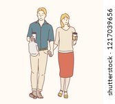 the man and woman are holding... | Shutterstock .eps vector #1217039656