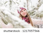 smiling young woman outdoors in ... | Shutterstock . vector #1217057566