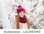smiling young woman outdoors in ... | Shutterstock . vector #1217057593