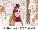 smiling young woman outdoors in ... | Shutterstock . vector #1217057620