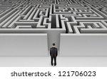 businessman in front of a huge... | Shutterstock . vector #121706023