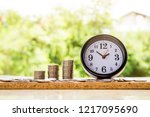 alarm clock and step of coins... | Shutterstock . vector #1217095690