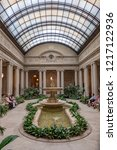 Small photo of NEW YORK CITY - APRIL 17, 2016: people rest in the atrium of the Frick Collection, former 5th Avenue mansion of steel magnate Henry Clay Frick.