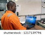 african marine engineer officer ... | Shutterstock . vector #1217139796