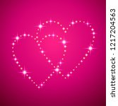 two led shining hearts  on pink ... | Shutterstock .eps vector #1217204563