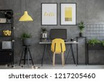 grey home office with yellow... | Shutterstock . vector #1217205460