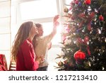 mom and daughter decorate the... | Shutterstock . vector #1217213410